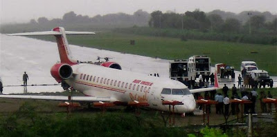 Pilot does a crash landing - The plane had skidded off the runway after its tyre burst
