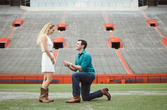 groom proposing in the middle of the Florida Gators football field