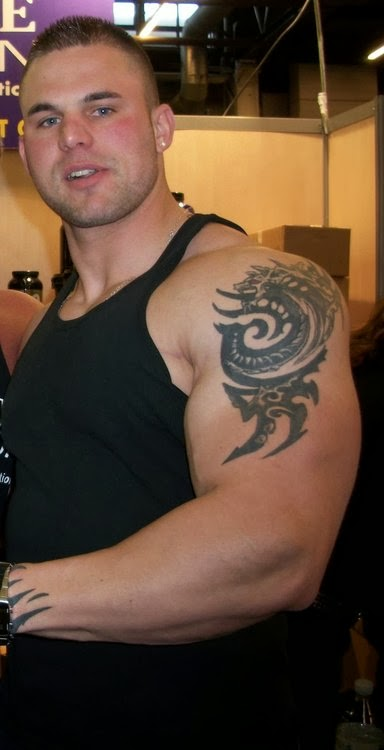 Young Bodybuilder's Bicep Tattoo