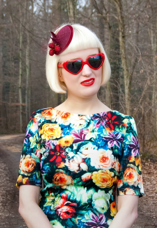 heart shaped glasses, red lips, berry fascinator