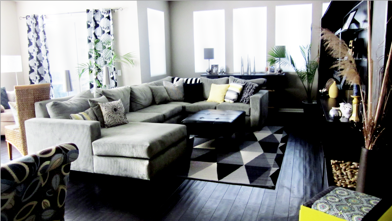 Cole barnett neutral black and white living room with for Neutral decor with pops of color
