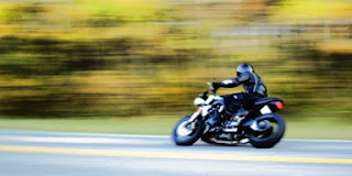 a picture of a motorcycle travelling left through the frame at a high rate of speed