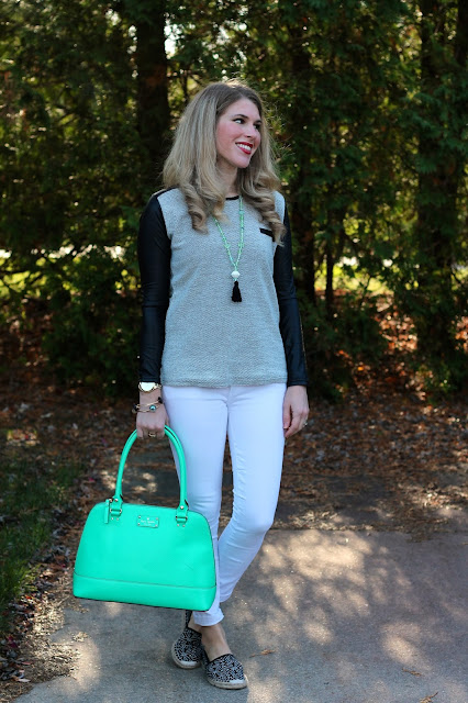 leather sleeve sweater paired with white jeans, espadrilles, and mint green accessories