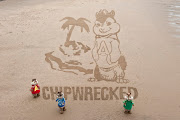 . a sand master class to help create this unique drawing. (giant sand art )