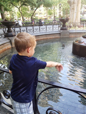 kid tossing pennies in fountain