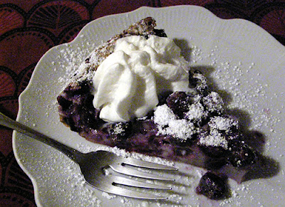 Slice of Blueberry Clafoutis with Whipped Cream