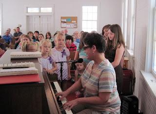 Laurel sings with kids at Rehobeth UMC