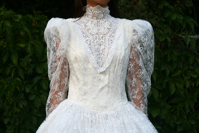 i found this gorgeous wedding dress at a thrift store sure its outdated and not within the time of whats in style right now but i can see why a certain