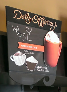 starbucks sign advertising pumpkin spice latte