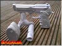 aluminum pistol casting with sprue and riser