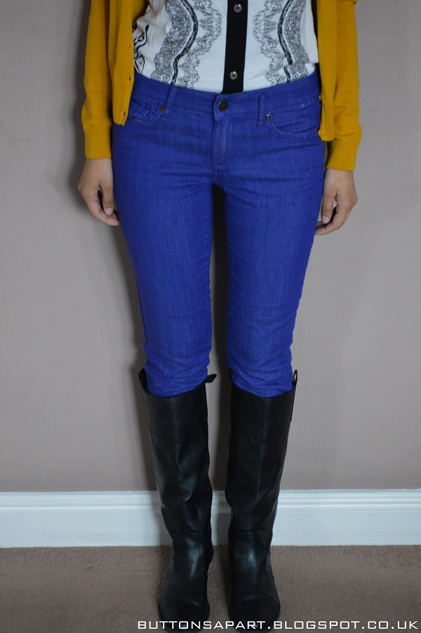 A picture of cobalt blue skinny jeans and black boots