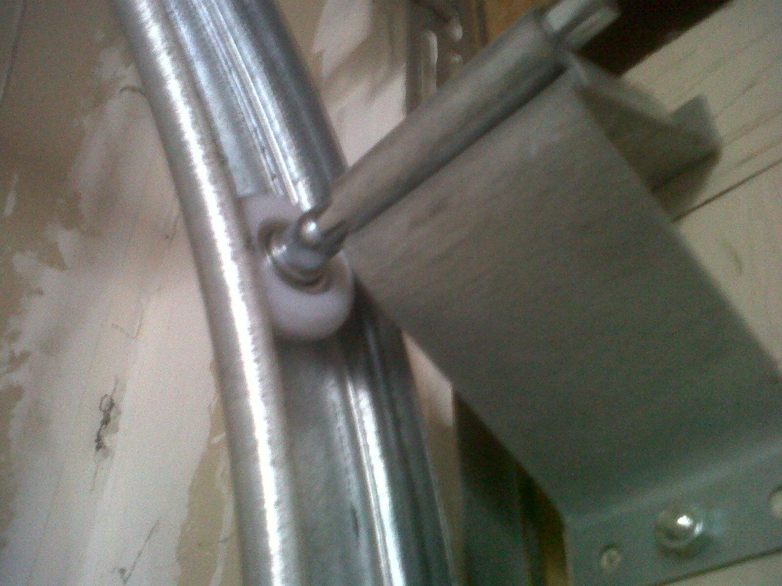 Baltic To Boardwalk Diy Garage Door Roller Repair