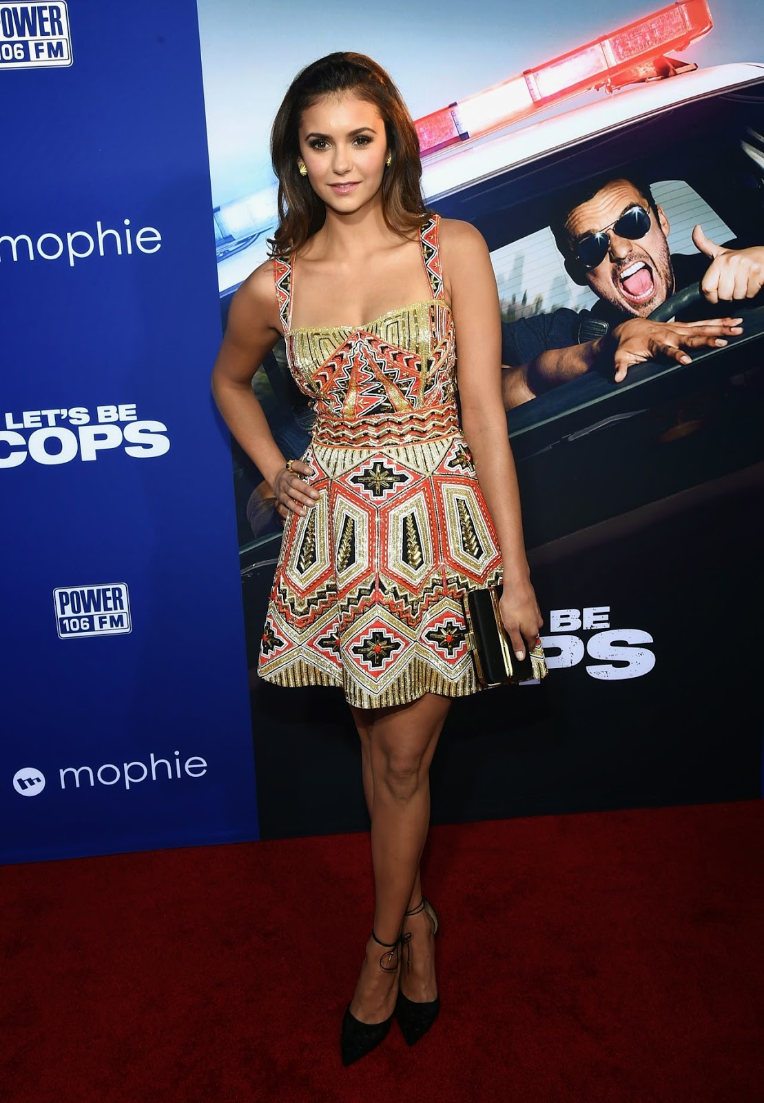 Nina Dobrev flaunts toned legs in a Zuhair Murad minidress at the 'Let's Be Cops' LA Premiere