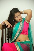 Anusha sizzling Pictures in half saree 065.JPG