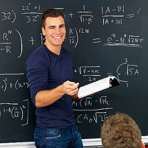 teacher standing in front of a chalkboard