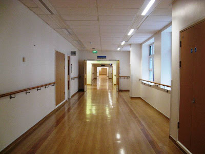 Deserted hospital corridor stretching into the distance