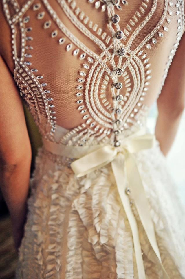 Beautiful lace detail on the back of this vintage ivory wedding dress