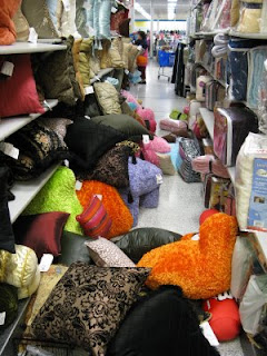 Ross dress for Less aisle with pillows and merchandise all over the ground floor