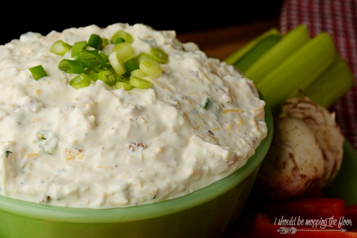 This Cowboy Dip is the perfect game day party food for your gathering.  It has a fun kick to it that makes it irresistible. It's perfect with cut veggies or chips.