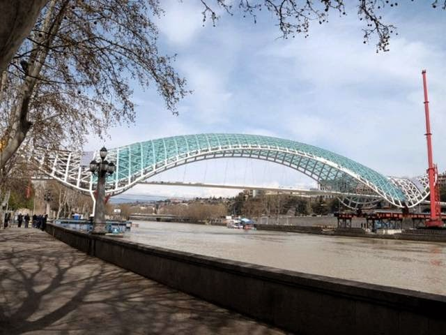"Spanning the Kura River in Georgia's capital of Tbilisi, this bridge connects the city's old and new districts. It also features motion-sensor lights for pedestrians. Its shape was supposed to evoke a marine animal, but it's been nicknamed ""Always Ultra"" by the locals, who see the shape as more of a maxi-pad."