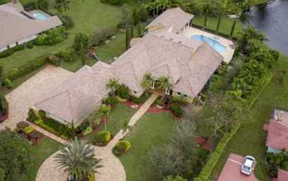 SOLD BY MARILYN: Gorgeous lake home in PARKLAND just below Boca