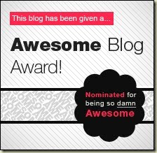 Awesome Blog award badge: A white square shaded with gray lines with a pink rectangle overlaying it that contains white text reading: This blog has been given a... and in black text on the big gray white main square text reads: awesome blog award. And then on the bottom right there's a black starburst kind of shape that contains smaller pink and white text that reads: Nominated for being so damn awesome.
