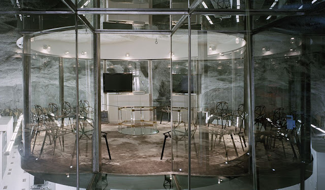 Photo of round glass office underground