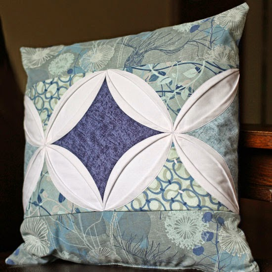 http://so-sew-easy.com/make-cathedral-window-cushion/