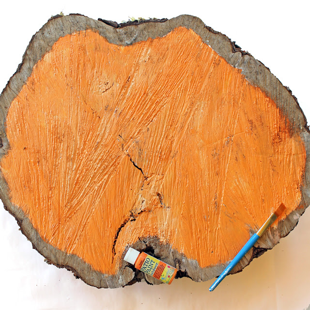 Make this easy painted pumpkin wood slice following this tutorial! By Katie Smith for DecoArt