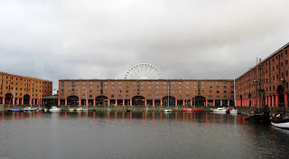 Dock buildings with a glimpse of Ferris wheel