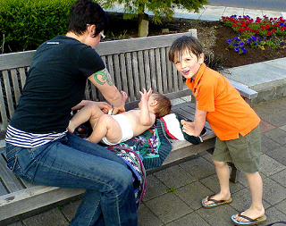 diaper change on the fountain bench - DSC00998