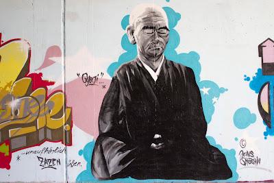 Frankfurt Germany, street art , graffiti, tagging, Buddhist monk