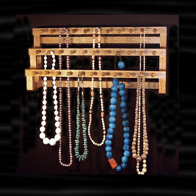 three-tiered wood rack for necklaces