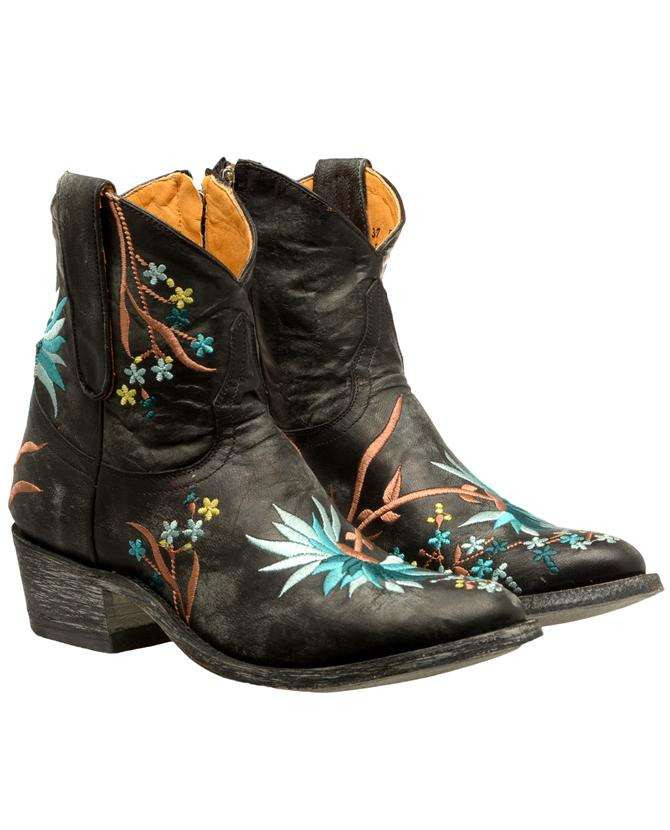 5c9616d79a5d5 Washed and aged black leather cowboy boots hand-embroidered with a floral  motif by Mexicana.