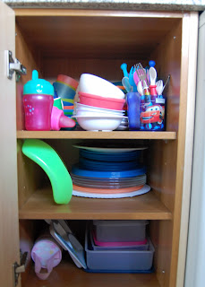 Cupboard full of baby and toddler feeding equipment