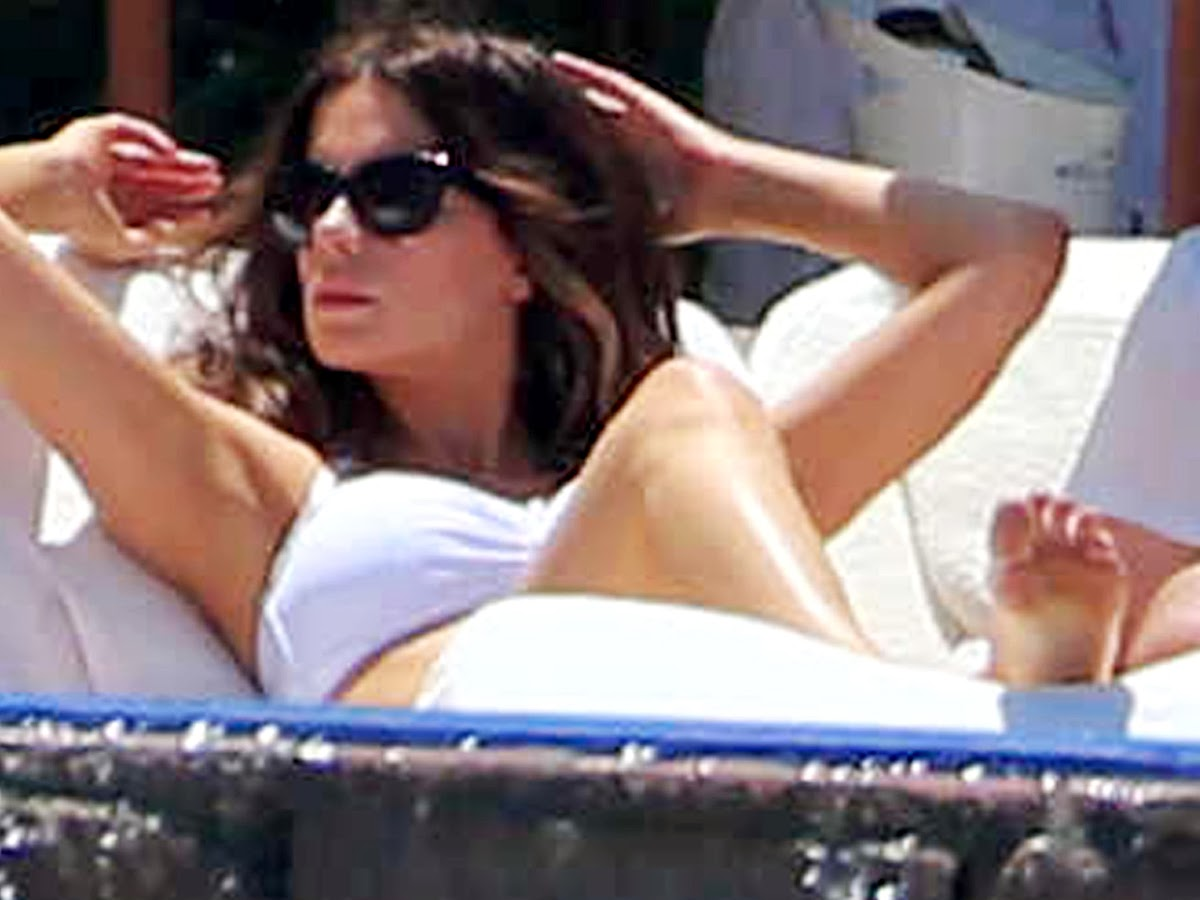 Kate Beckinsale in a white bikini
