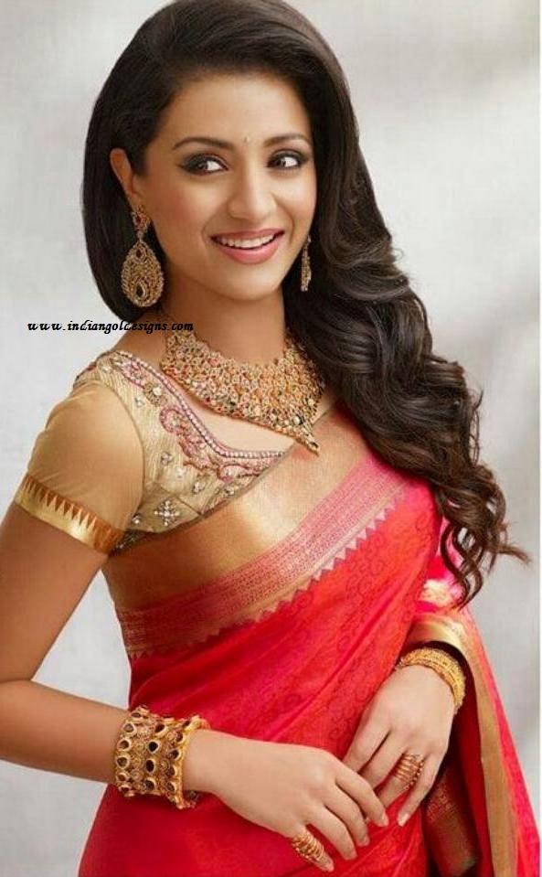 Checkout actress trisha in orange bridal saree with zari border and