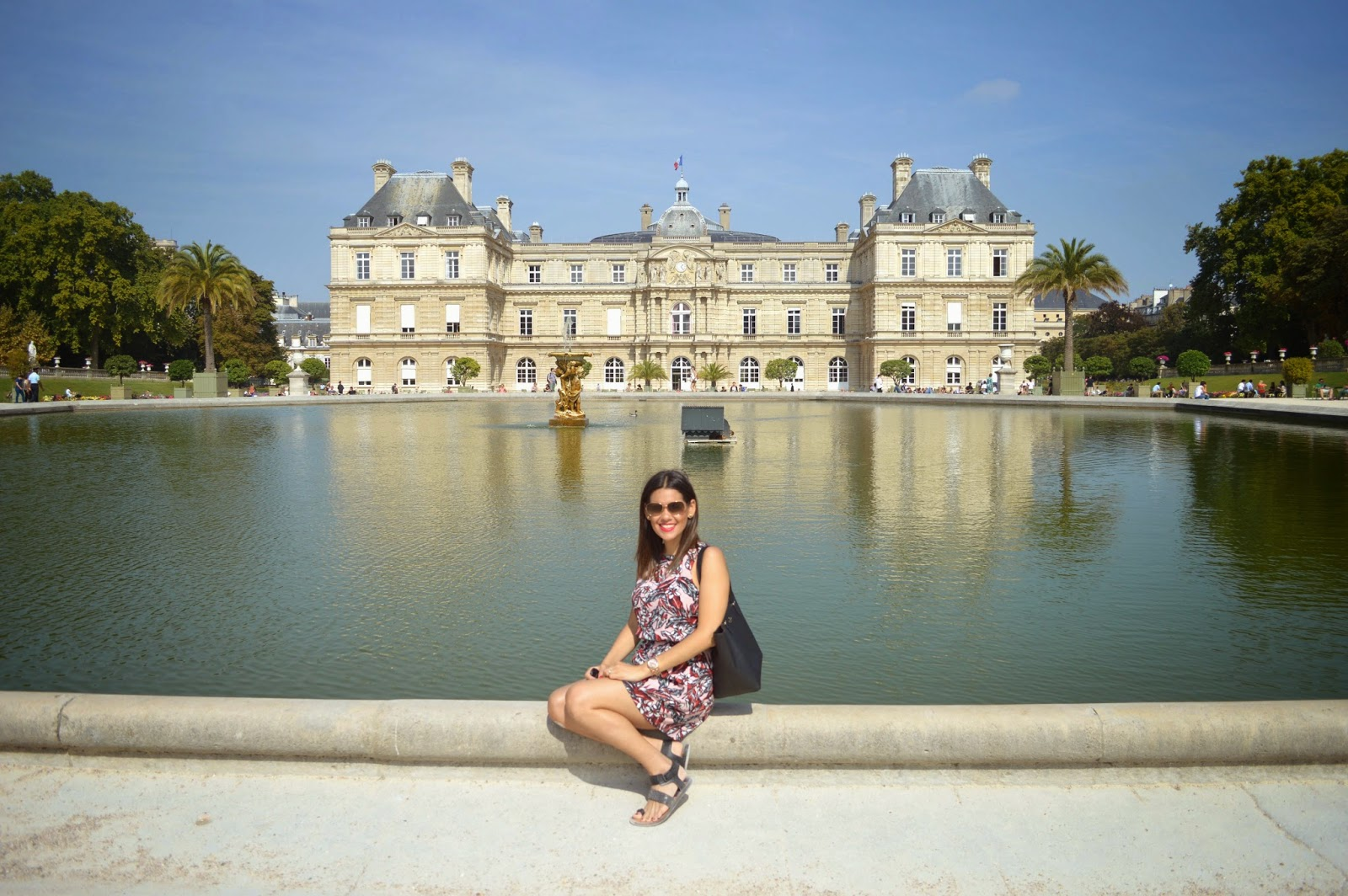 Marifer at the fountain in front of the Luxembourg Palace.
