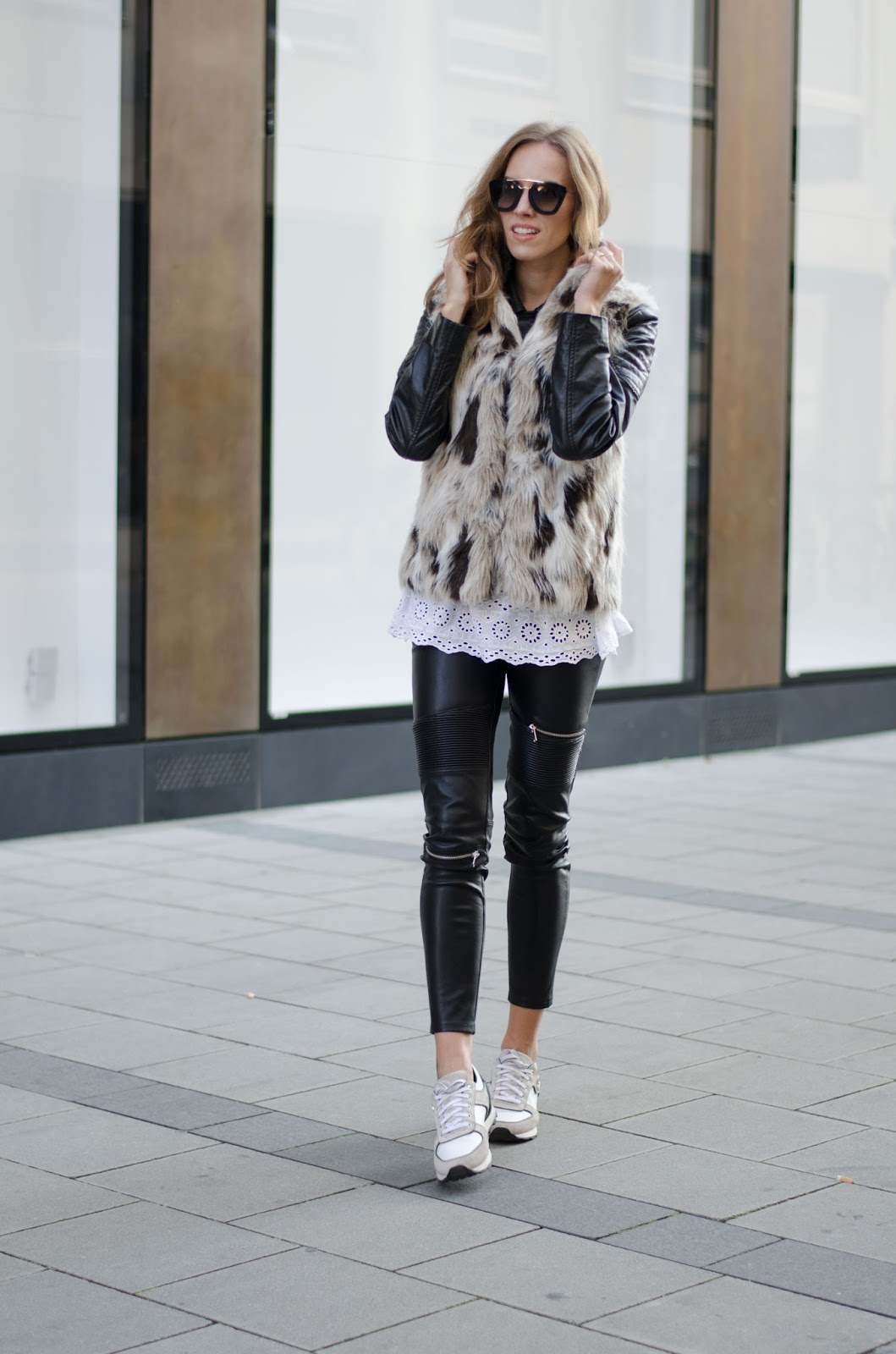 kristjaana mere fall look black white fur vest leahter pants sneakers
