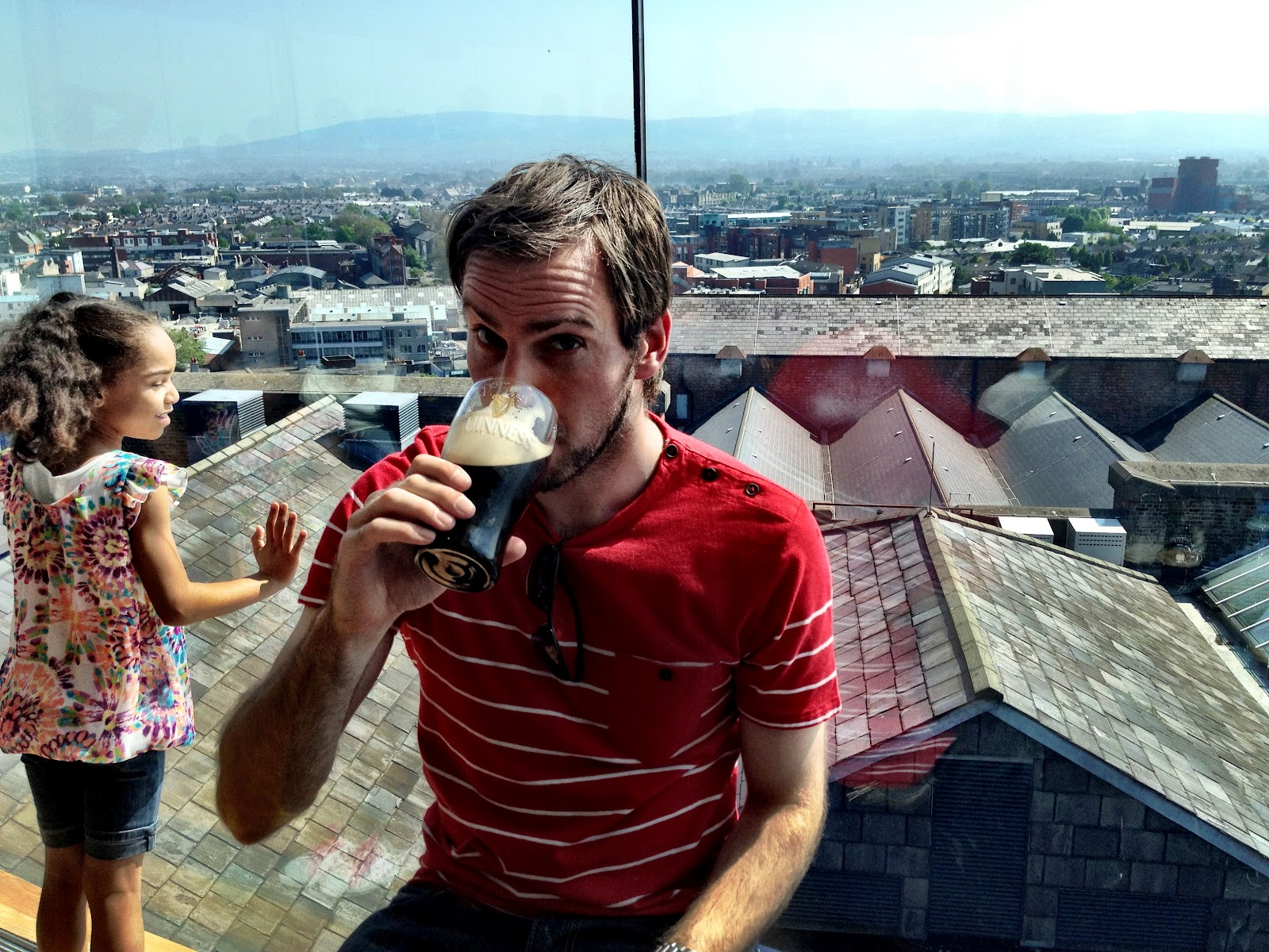 Simon drinking a pint of Guinness in the Gravity Bar