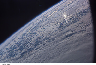 UFO above Earth photo by NASA