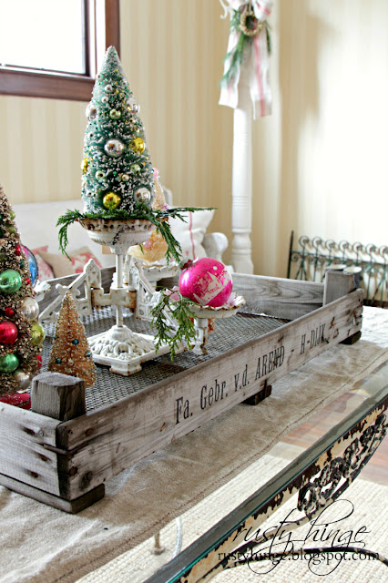 Christmas vignette of vintage bottle brush trees in a Dutch tulip crate