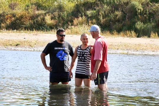 L-R: Jakeman Moanaroa, Peter Barefoot, Michael Harbers. Adult baptism in the Ngaruroro River, near the Chesterhope Bridge, Pakowhai, Hastings photograph