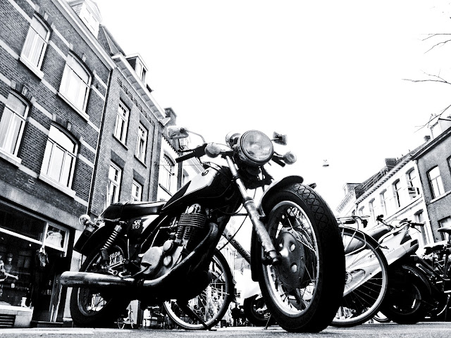 Looking at a parked motorcycle from an excellent outdoor bar in Maastricht, Holland.