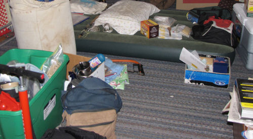 camping stuff on floor
