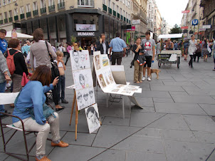 Watercolour artists and paintings on Stephansplatz  in Vienna.