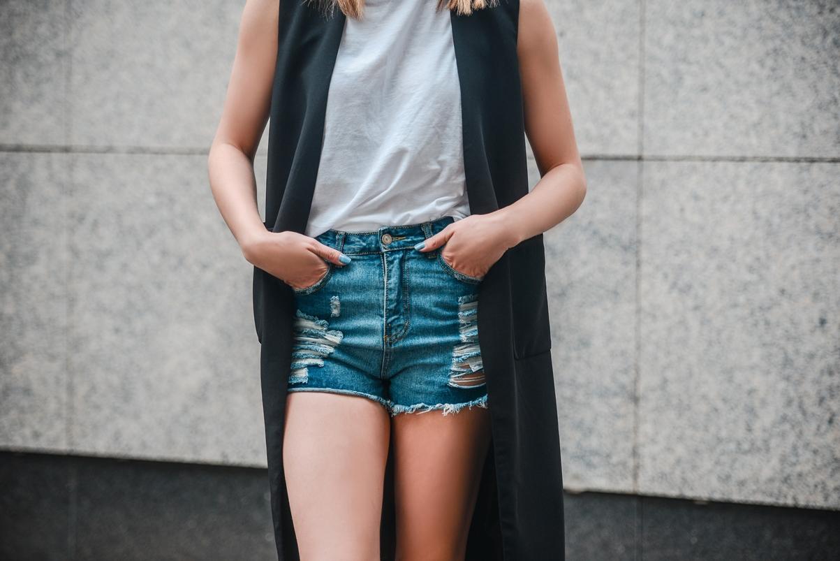 high waisted ripped shorts, longline black vest gilet, black hairy slip on sneakers plimsolls, style blogger, fashion blog