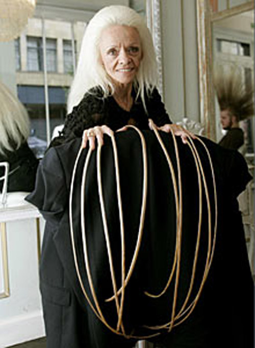 Woman goes into record books with world's longest fingernails