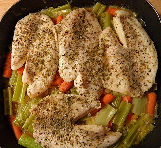 Pan with Four Cooked Fish Fillets on Bed of Veggies