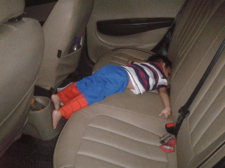 Aarav sleeping in the car